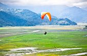 Paraglider flying over the beautiful Pokhara valey, Nepal.  poster