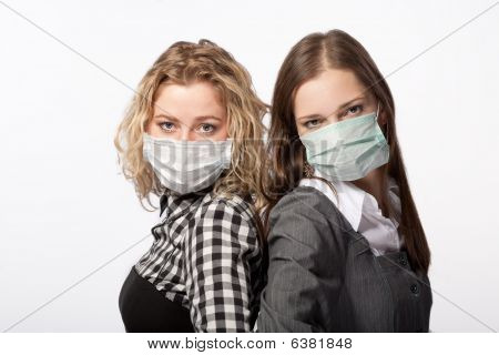 young couple in protection mask stand against swine flu and viruses