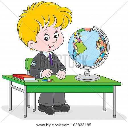Schoolboy at geography lesson