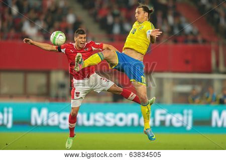 VIENNA,  AUSTRIA - JUNE  7 Aleksandar Dragovic (#3 Austria) and Zlatan Ibrahimovic (#10 Sweden) during the world cup qualifier game on June 7, 2013 in Vienna, Austria.