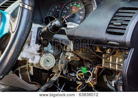 Closeup car electric repair Repair of electrical wiring in the car. poster