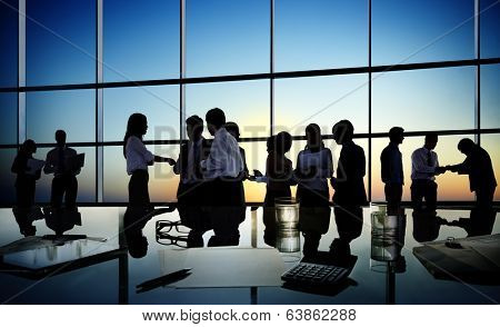 Group of business people discussing in a conference room.