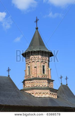 Close-up image of the tower of Neamt MonasteryMoldaviaRomania.It is a Romanian Orthodox religious settlement one of the oldest and most important of its kind in Romania. It was built in 14th century and it is an example of medieval Moldavian architecture. poster