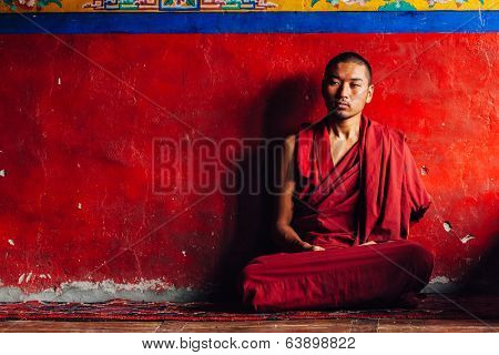 DISKIT, INDIA - SEPTEMBER 12, 2012: Unidentified Tibetan Buddhist monk in Diskit gompa. Diskit is the oldest and largest Buddhist monastery in Nubra Valley of Ladakh, India