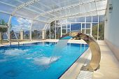 indoor swimming pool at modern home poster