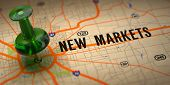 New Markets Concept - Green Pushpin on a Map Background with Selective Focus. poster