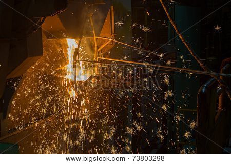 Operater Tapping Molten Metal