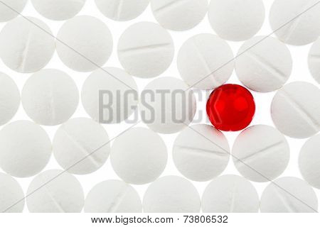 white tablets in contrast with a red tablet, symbol photo for bullying and individuality