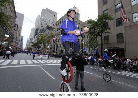 Gym Dandies juggle in unicycles