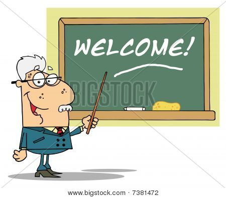 Senior Male School Teacher Pointing To A Welcome Chalkboard
