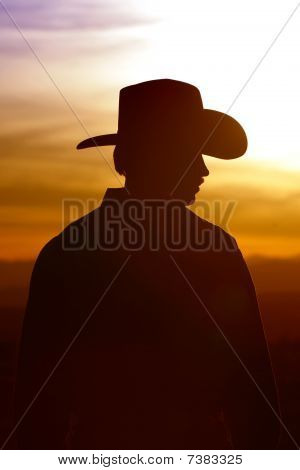 Cowboy Silhouette and Sunset Sky