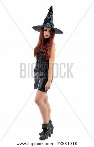 pretty young redhead witch, isolated against white background