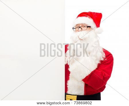 christmas, holidays, advertisement and people concept - man in costume of santa claus with white blank billboard making hust gesture