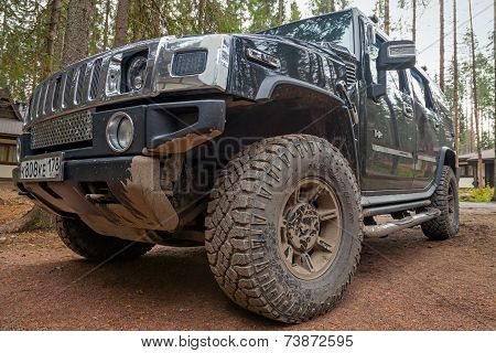 Black Hummer H2 Car Stands On Dirty Road