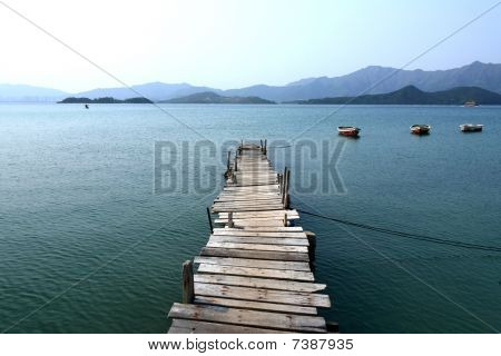 Looking over a pier and a boat