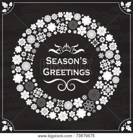 Vintage style season's greetings on chalkboard
