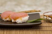 Two pieces of tuna sushi on a Japanese plate poster