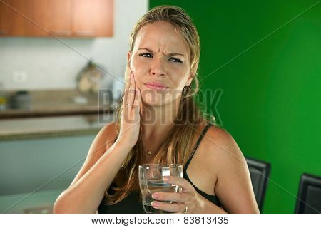 Young Woman With Toothache Drinking Cold Water