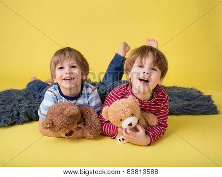 Happy Kids, Siblings, Hugging Stuffed Toys