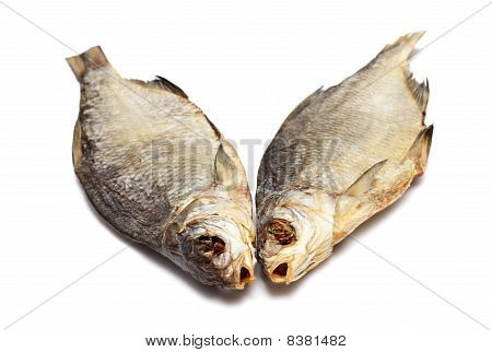 Two dried fishes isolated on white background poster