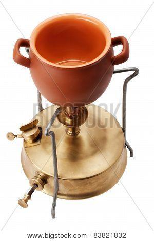 kerosene burner and ceramic pot isolated on white background poster