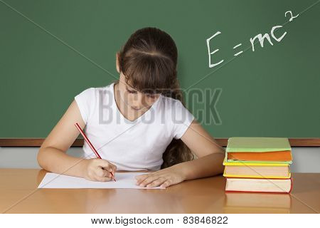 Cute Schoolgirl studying physics at the classroom poster