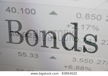 """Inscription """"Bonds"""" on PC screen. Trading terminal as background."""
