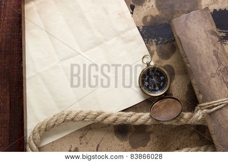 Roll Of Parchment With A Compass