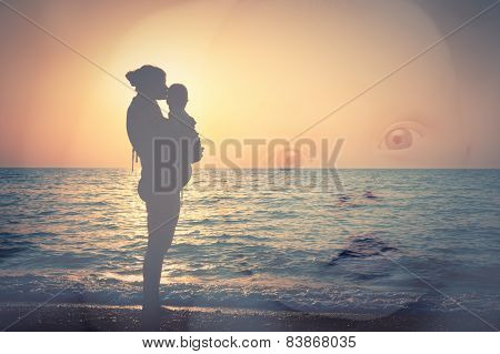 Silhouette Of Mother And Child On The Beach, And A Child's Face