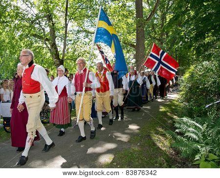 People at Midsummer celebrations and Norwegian - Swedish wedding