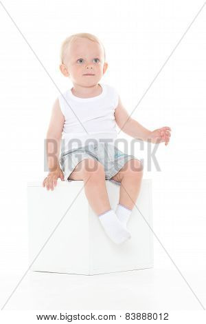 Baby Boy Sits On Cube.
