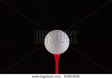 Golf Ball And Red Tee