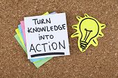 Turn knowledge into action phrase pinned on bulletin board poster
