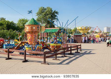 Children Carousel In City Amusement Park
