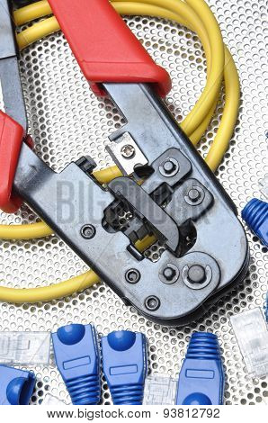 Crimping tool with network cable and connectors poster
