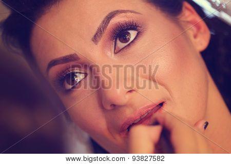 Hands Of Make Up Artist Applying Lipstick On Bride
