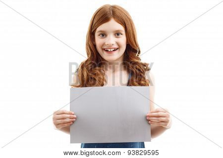 Positive little girl holding  sheet of paper