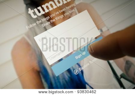 Tumblr Page With Finger Touch On Sign Up Button In Register Page