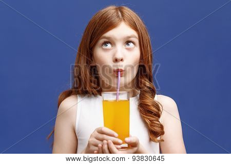 Nice girl drinking orange juice