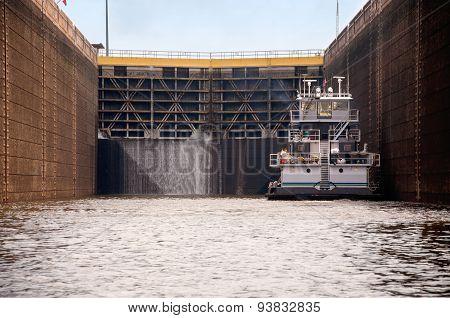 Tugboat In A Lock