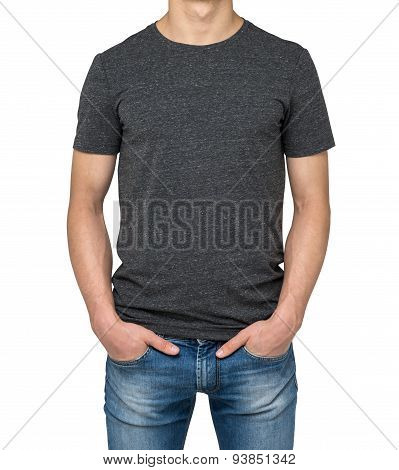 Man Wearing Dark Grey T-shirt Isolated On White Background. Hands In The Pockets.