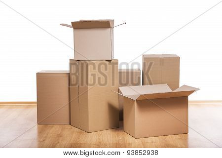 Moving boxes on the floor.