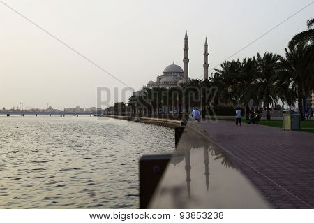 Sharjah City Mosque With Gulf, Bridge And Palms, Conctruction And Modern Architecture Concept. Islam