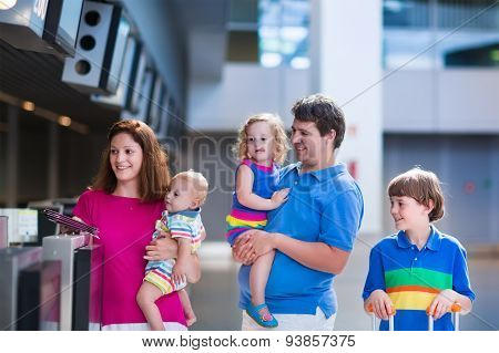 Family With Kids At Airport