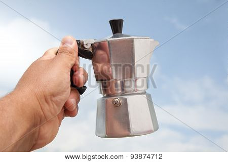 Man Holding Percolator