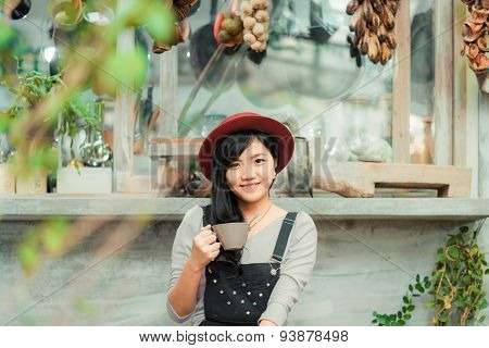 Business Asian Woman Holding Coffee Cup In Coffee Shop