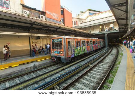 ATHENS, GREECE - APR 13, 2015: Urban metro station with subway train. The Athens Metro is a rapid-transit system opened as a conventional steam railway in 1869, and which was electrified in 1904.