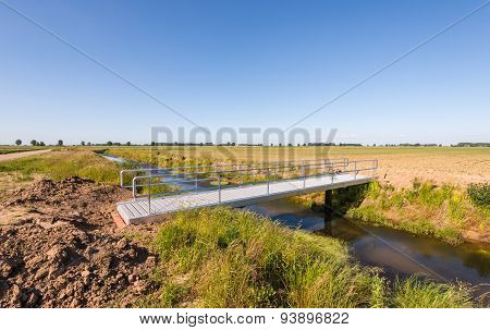 Newly Constructed Modern Aluminum Bridge Over A Creek