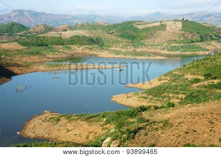 Vietnam countryside landscape impression chain of mountain cover Nam Ka lake bare hill from deforestation amazing scene with floating house on river residential on water poster