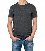 Man wearing dark grey t-shirt isolated on white background. Hands in the pockets. poster